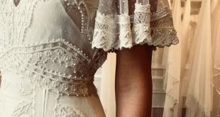 Designed in a delicate light silk georgette and dotty tulle, the bohemian France...